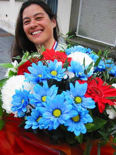 Carla with her Red White Blue bouquet and medal